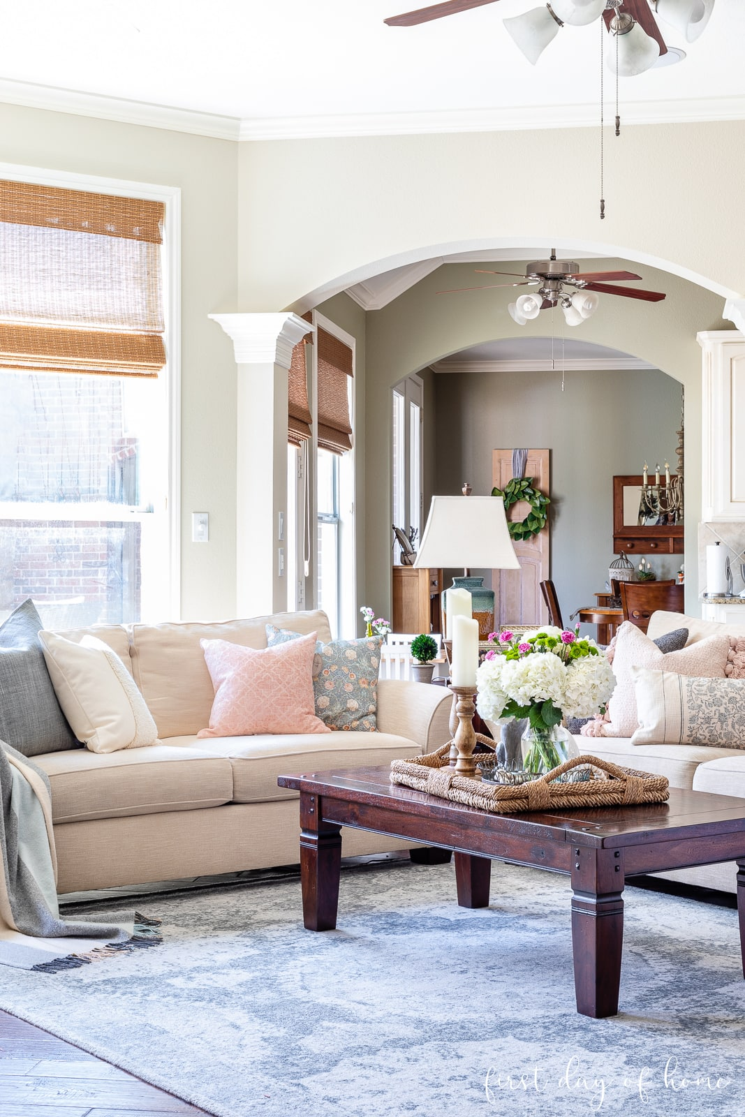Spring coffee table accents in living room with throw pillows on sofas in background