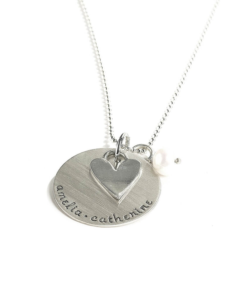 Silver stamped necklace with names of kids