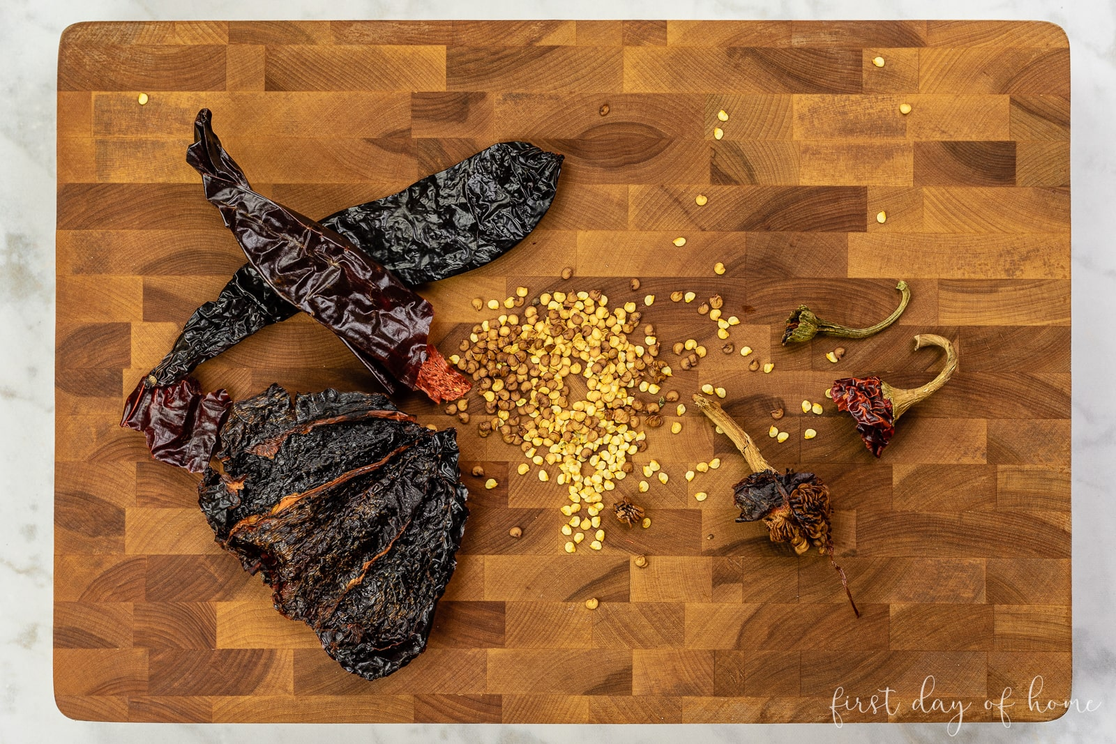 Dried chili peppers with seeds removed on cutting board