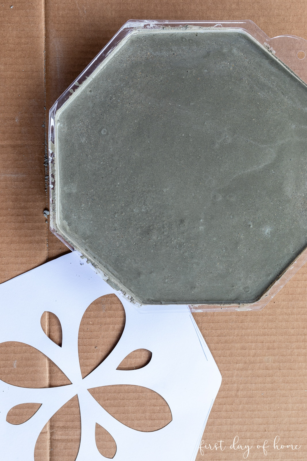 Stepping stone mold filled with concrete