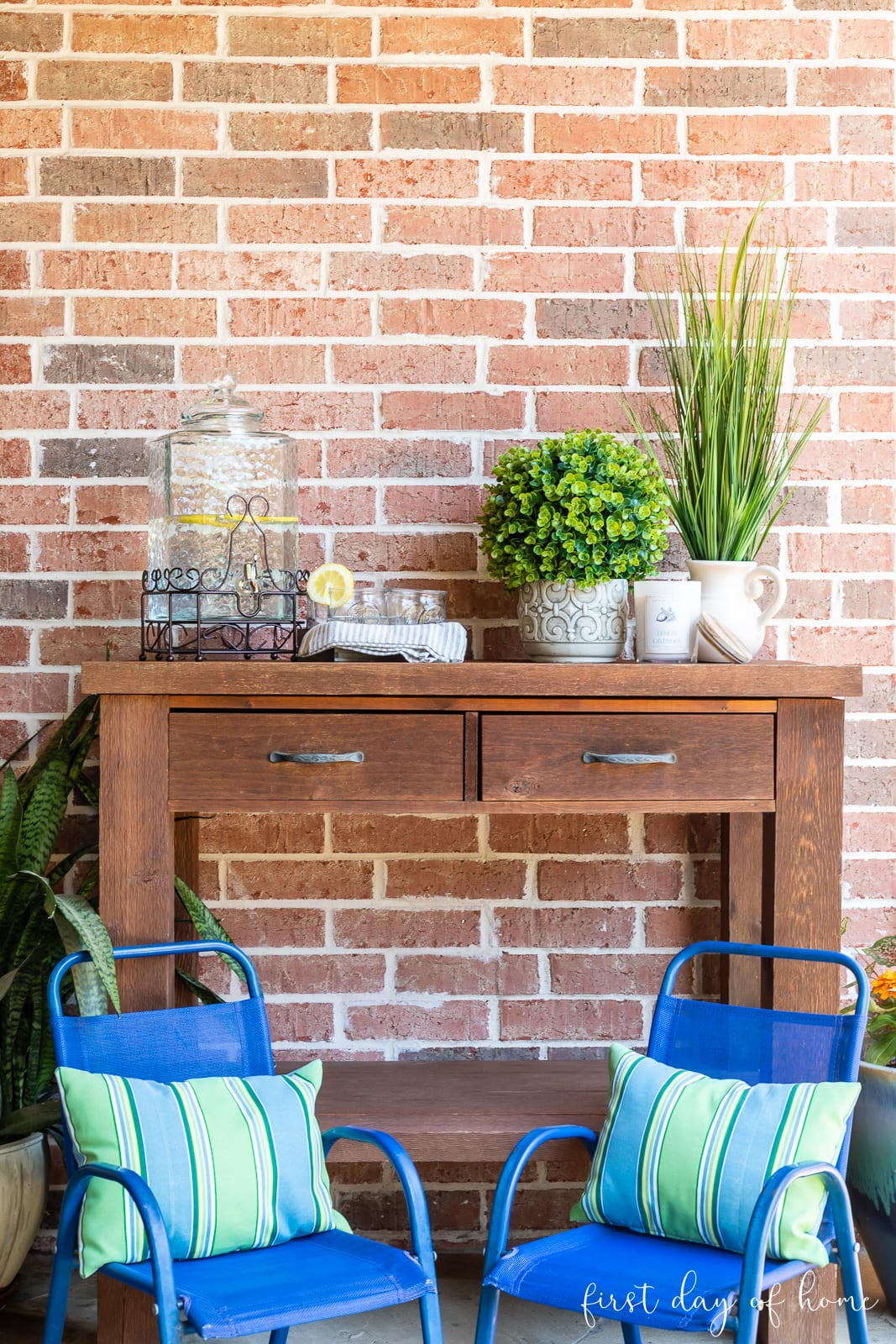 Cedar bench outdoors with greenery and lemonade serving station