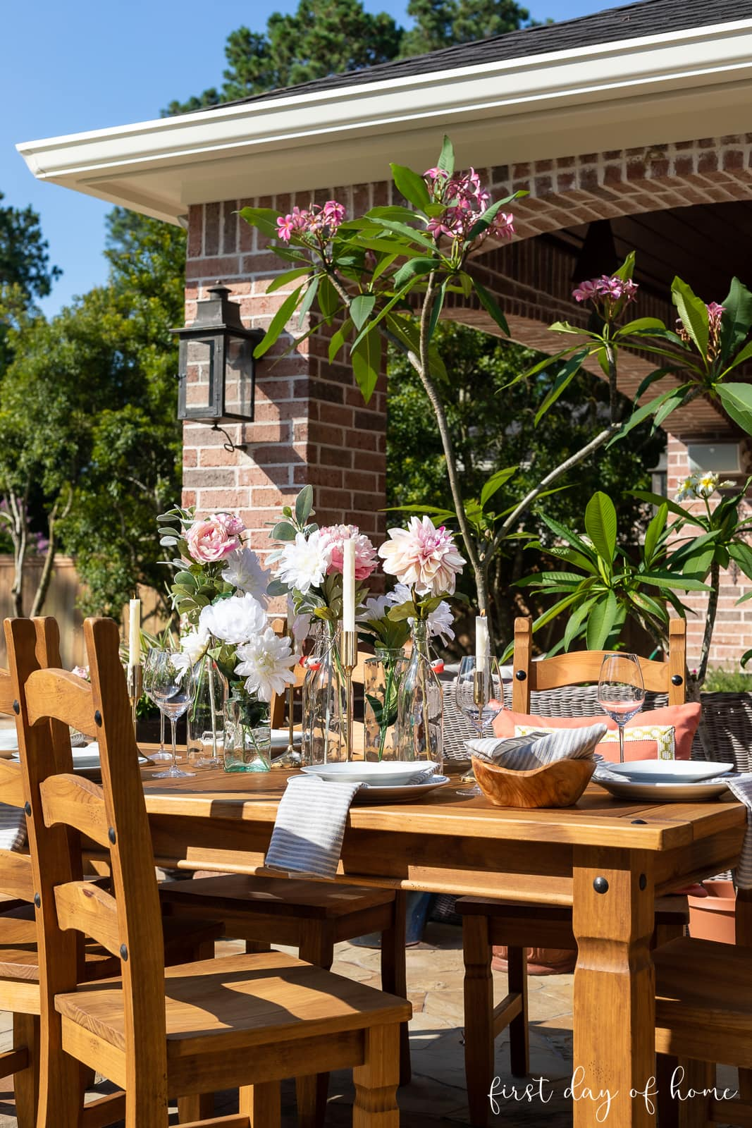 Outdoor table with floral centerpiece