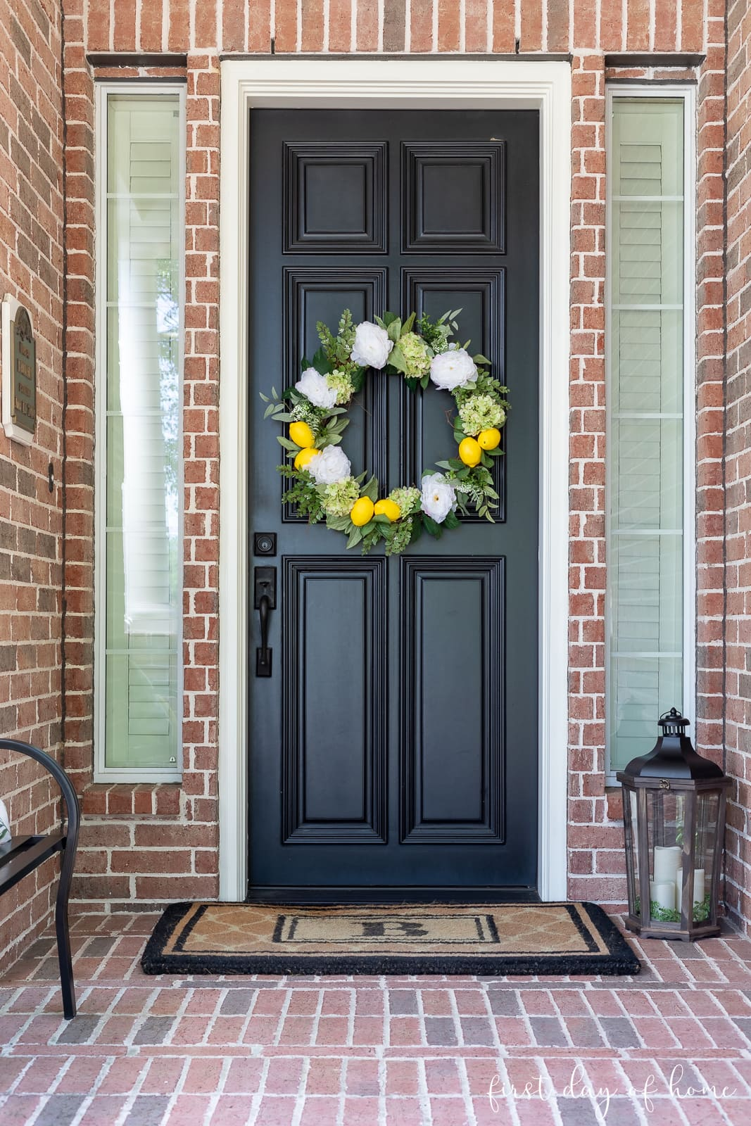 Front porch with citrus and hydrangea wreath and lantern