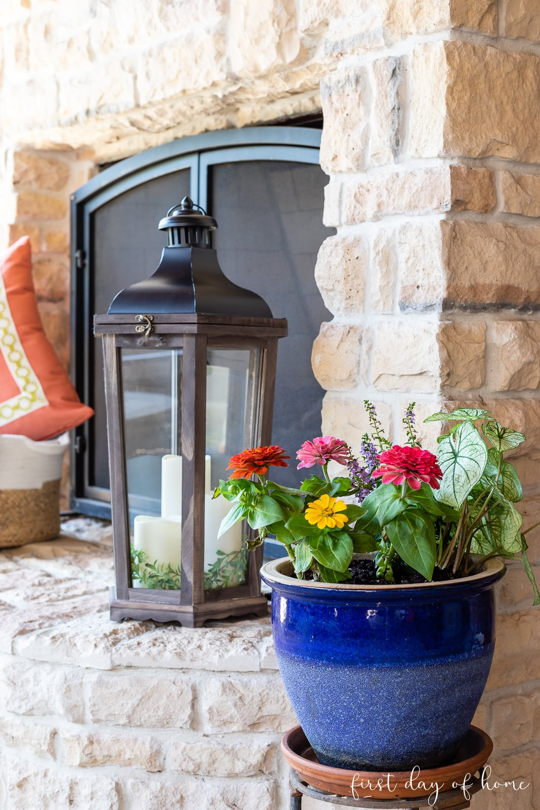 Potted plant by fireplace with lantern in background