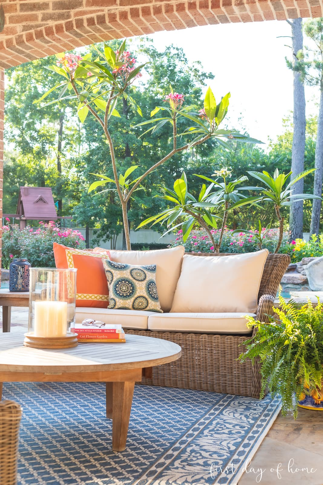 Back patio with area rug, settee and outdoor throw pillows at dawn