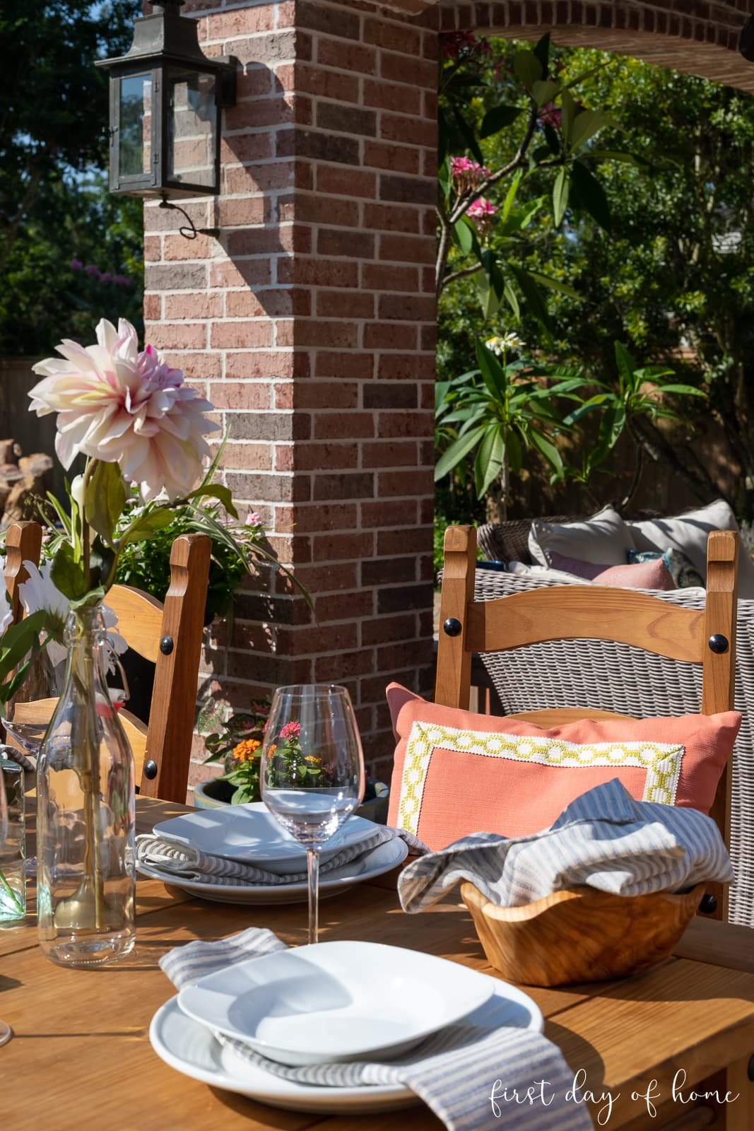 Outdoor dining table with floral centerpiece