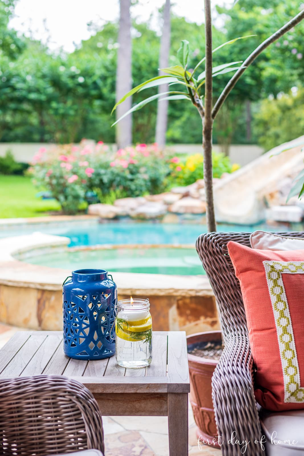 Mosquito repellent mason jar luminary with lantern on outdoor patio with pool in background