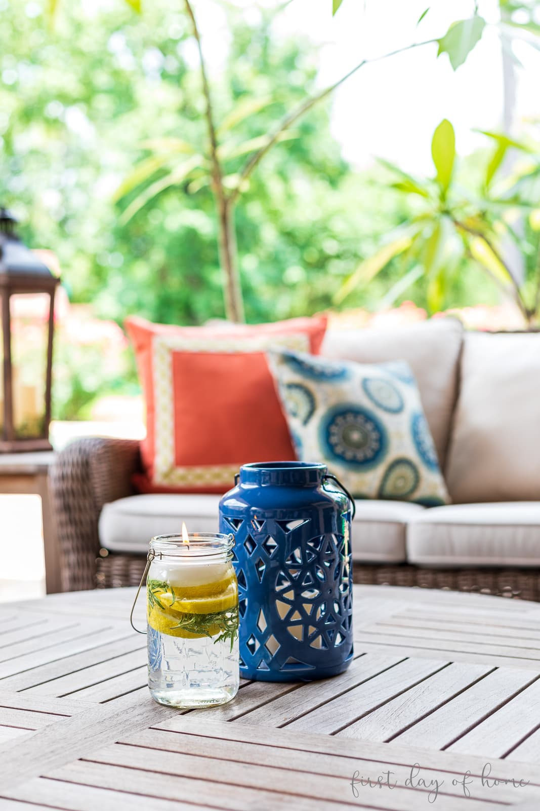 Mason jar luminary and lantern on outdoor patio table