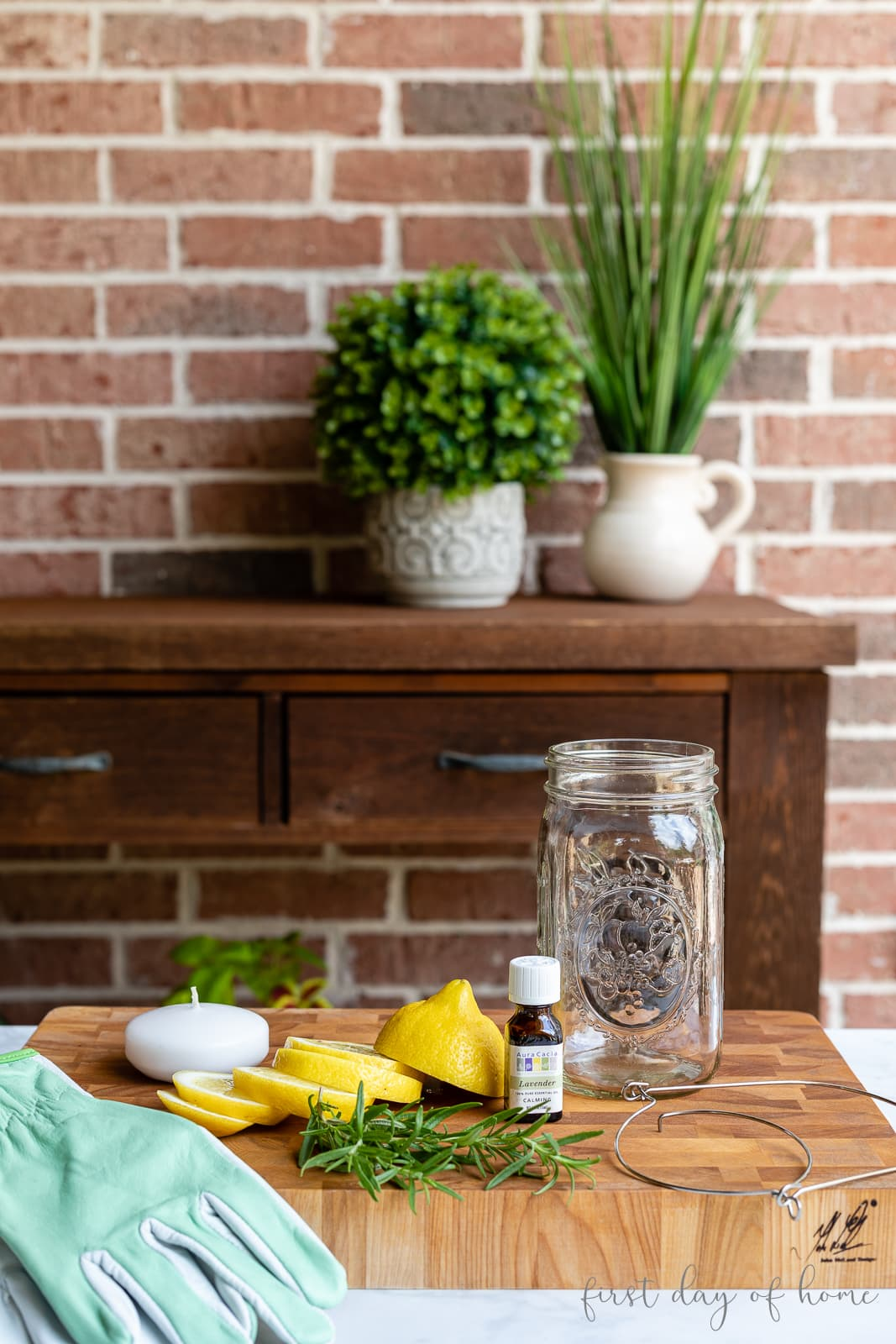 Mason jar luminary supplies with lemon slices, rosemary and essential oil