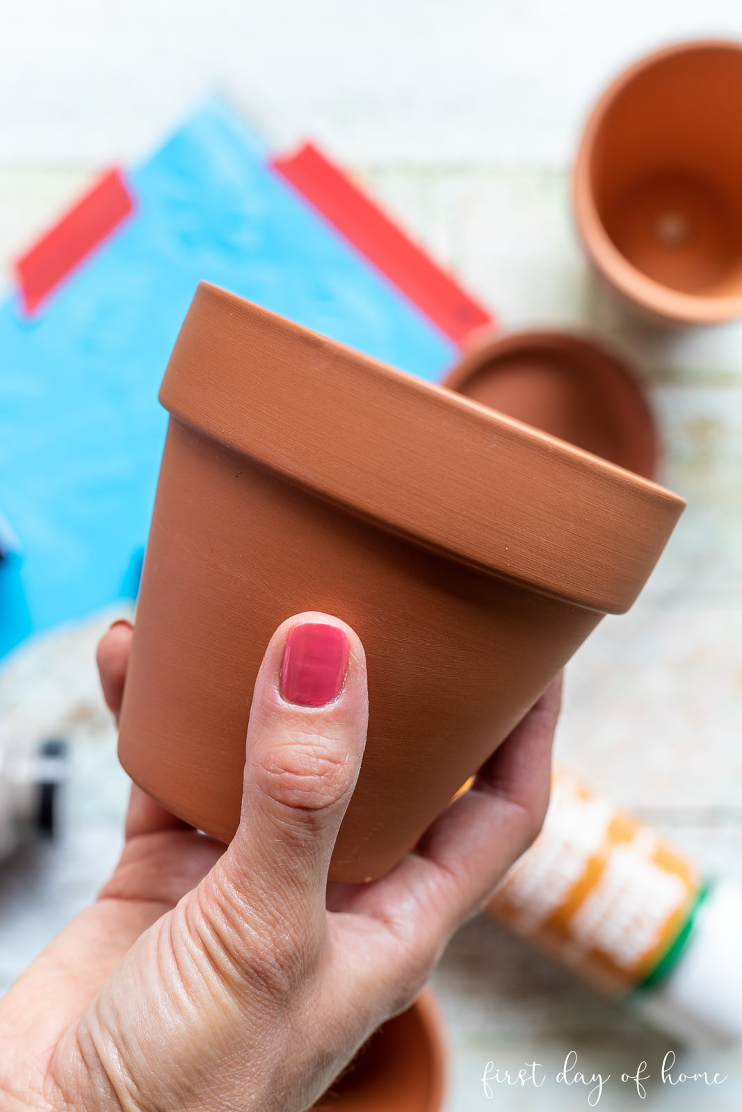 Plain terracotta pot after sealing and before painting