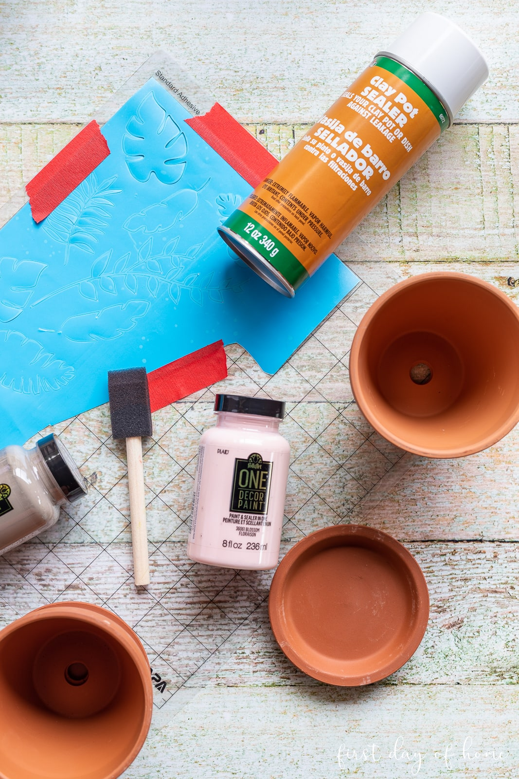 Terracotta pots, clay pot sealer, outdoor paint, and stencil film supplies for painted flower pot crafts