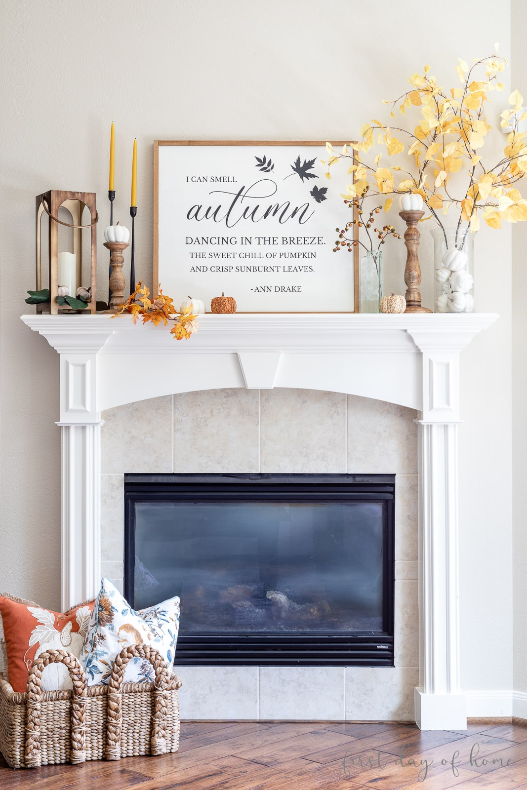 Fall farmhouse mantel decor with faux florals and DIY farmhouse sign in center