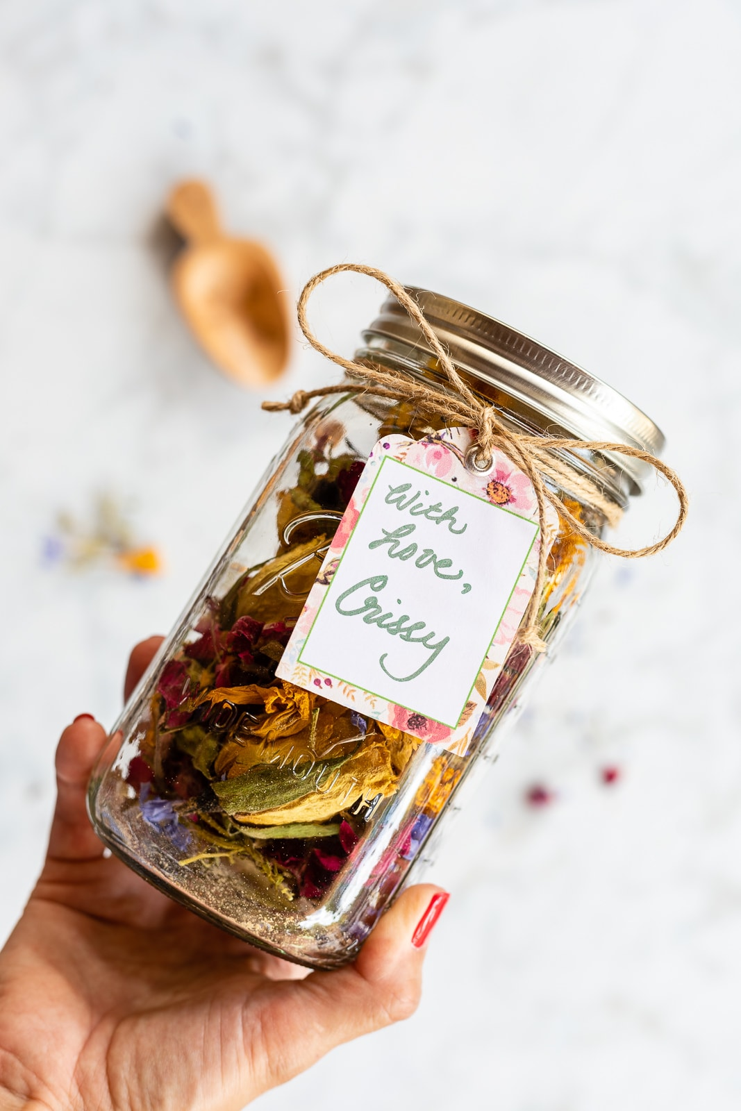 Homemade potpourri packaged as a gift in a mason jar with a gift tag