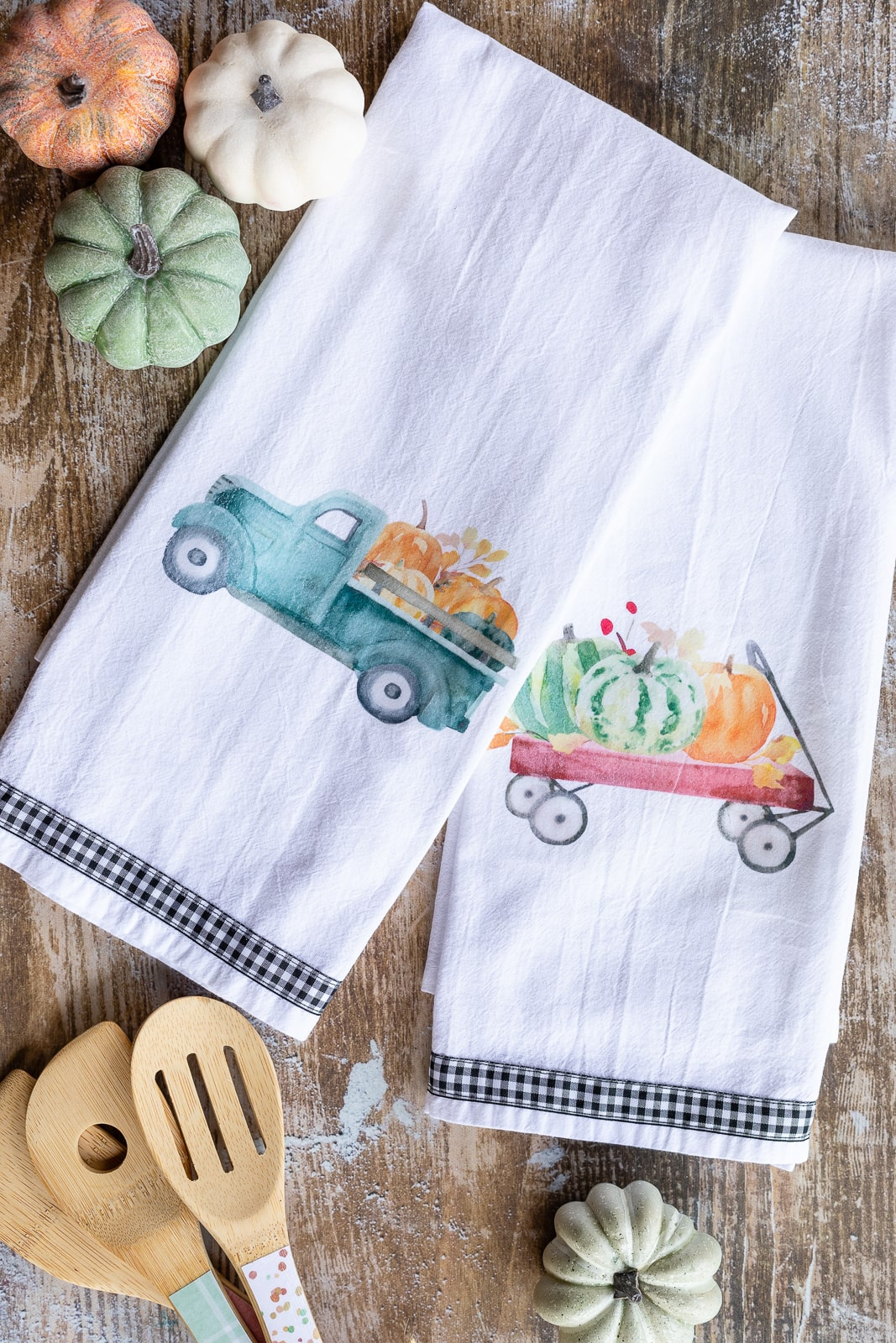 DIY tea towels made with image transfers showing farmhouse pumpkin wagon and truck theme