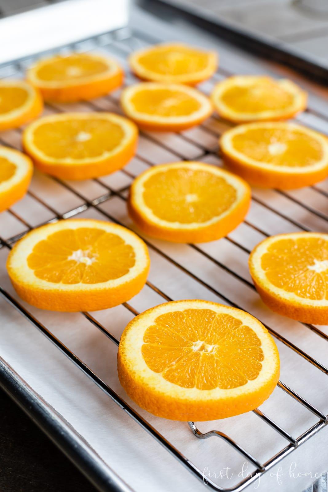 Raw orange slices on baking rack