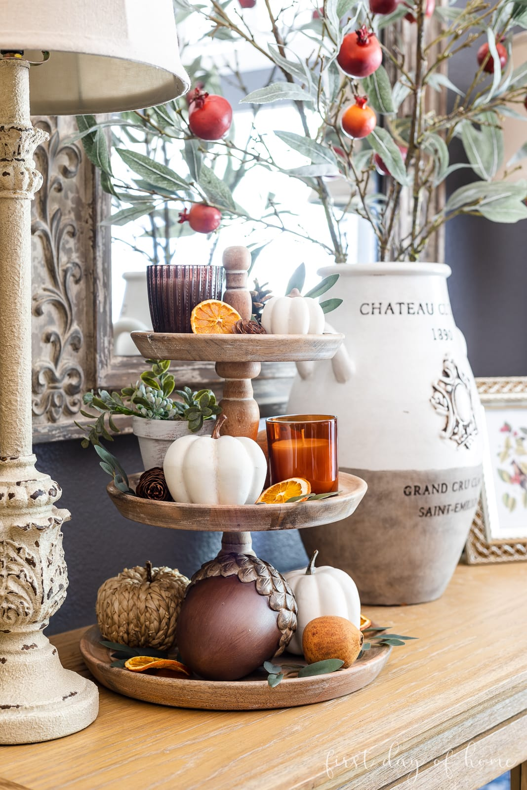 Tiered tray with fall decor accents and dried orange slices