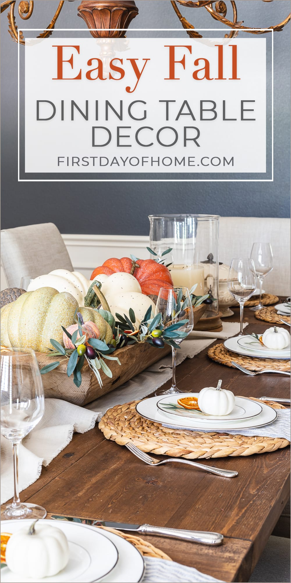 """Fall dining table with dough bowl centerpiece filled with faux pumpkins and olive stems. Text overlay reads """"Easy Fall Dining Table Decor"""""""